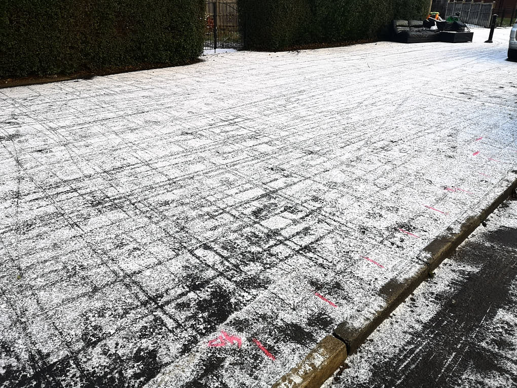 """""""Tramline"""" markings in the snow on the pavement from the GPR antenna"""