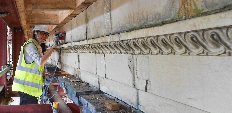 GPR surveyor scanning masonry facade to locate embedded metal