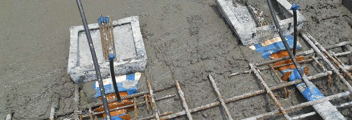 Tendon ducts being cast into concrete slab