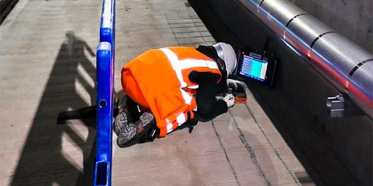 Surveyor using GPR o verify platform reinforcement detail