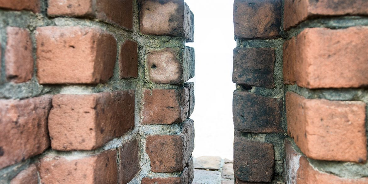 Two brick walls with a gap in-between for thickness measurement
